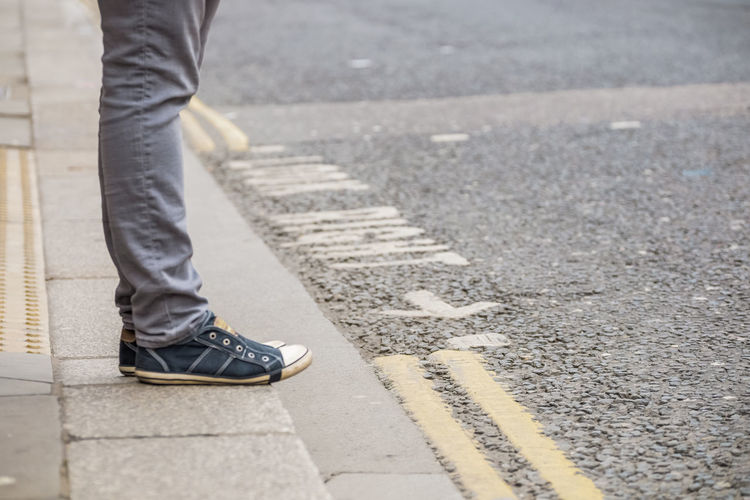 LOOK RIGHT -> // Careful Casual Clothing London Lifestyle Crossing The Street Footwear Human Foot Indication Jeans Lifestyles Lines Low Section Markings Pavement Person Safety Safety First! Shoe Standing Street Traffic Traffic Sign Waiting Walking Warning Warning Sign