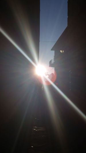 The City Light Sunbeam Sunlight Lens Flare Sun Light Beam No People Day Astronomy Eyesight Walking Around Taking Pictures Enjoy The New Normal Nothingisordinary Built Structure Road Lighting Equipment Thinking In Front Of Travel Destinations Montalcino. Benvenuo Brunello 2017