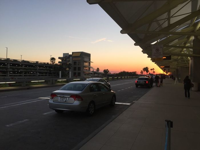 Sundown at mco Nanoisincontrol Orlando International Airport Airport Car Sunset Land Vehicle Architecture Built Structure Mode Of Transport Transportation Building Exterior Sky Road Outdoors City Day No People
