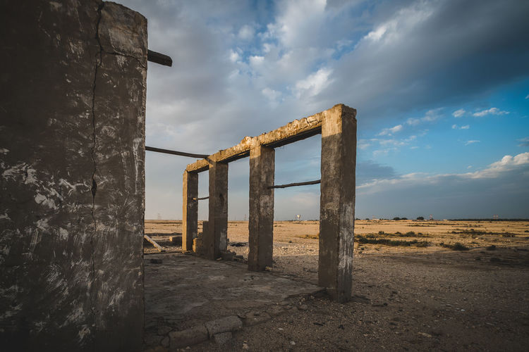 Sky Cloud - Sky Built Structure Architecture Land Nature Sea No People Day Water Old Beach Abandoned Outdoors Weathered Tranquil Scene Non-urban Scene Field Wood - Material Architectural Column Deterioration