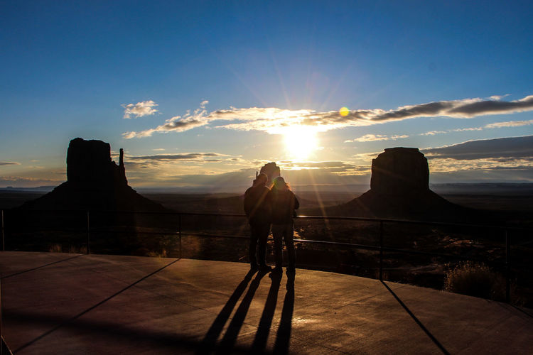 Sky Sunset Cloud - Sky Real People Sunlight Nature Mountain Lifestyles Silhouette Men Beauty In Nature Scenics - Nature People Sun Sunbeam Leisure Activity Travel Rear View Tranquility Lens Flare Outdoors Arizona Arizona Sky Arizona Sunsets Arizona Desert The View Hotel Monument Valley