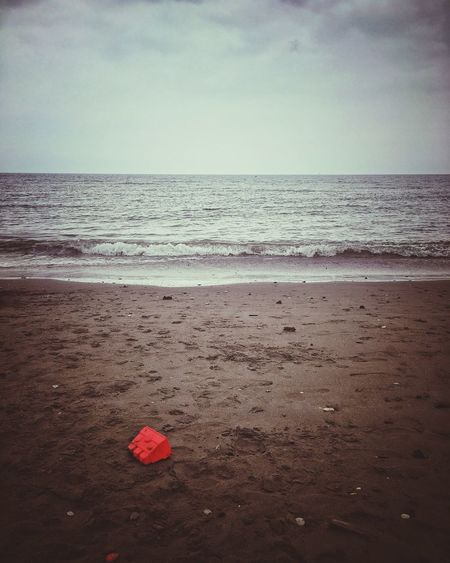 Beach Sea Horizon Over Water Water Sand Shore Tranquility Nature Tranquil Scene Scenics No People Sky Vacations Red Beauty In Nature Outdoors Day Wave