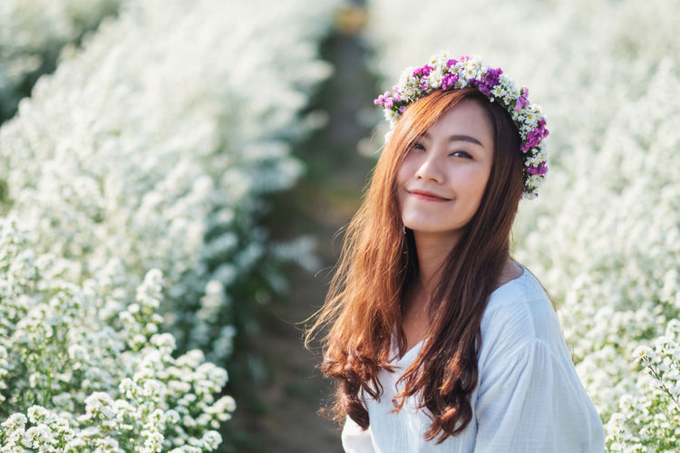 Beautiful young woman at field