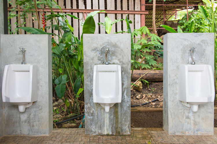 Urinals on concrete blocks outdoors