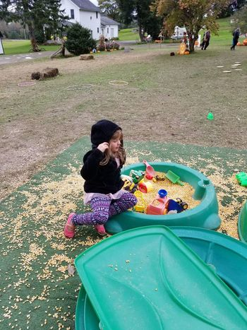 child playing in the corn Child Sand Box Childhood