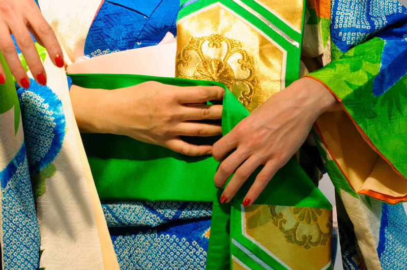 Close-Up Of Hands In Traditional Garments