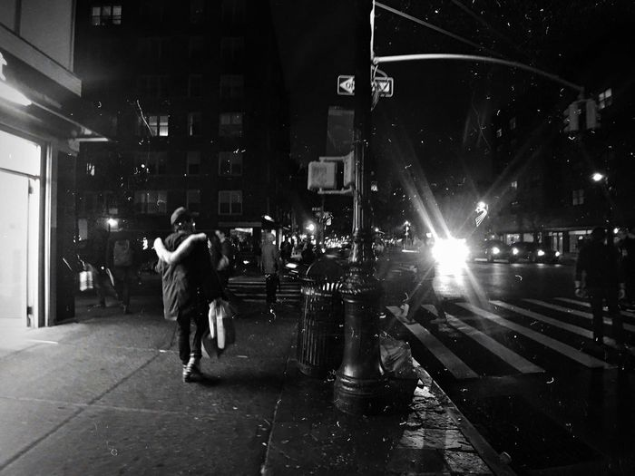 Blurred motion of woman in city at night