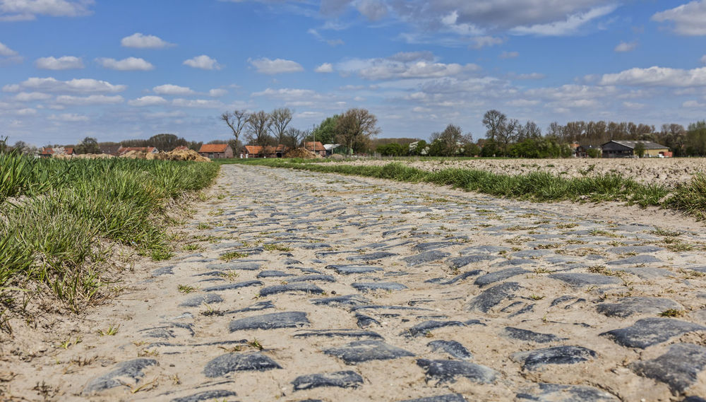 Cobblestone road. Landscape_Collection Paved Perspective Perspectives Road Background Cobbled Cobbled Road Cobblestone Cobblestone Road Countryside Direction Field Horizon Over Land Land Landscape Nature Outdoors Paved Road Scenics Scenics - Nature The Way Forward