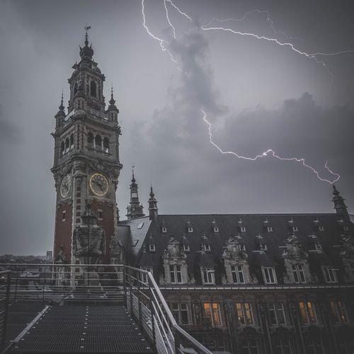 Lightning over clock tower during rainy season