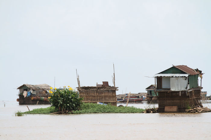 Boat Building Exterior Cambodia Clear Sky Corrugated Iron Day Floating House Flowers Green Kampong Khleang, Cambodia Lake Nature No People Outdoors River Rural Scene Sky Tonle Sap Tranquil Scene Travel Destinations Water