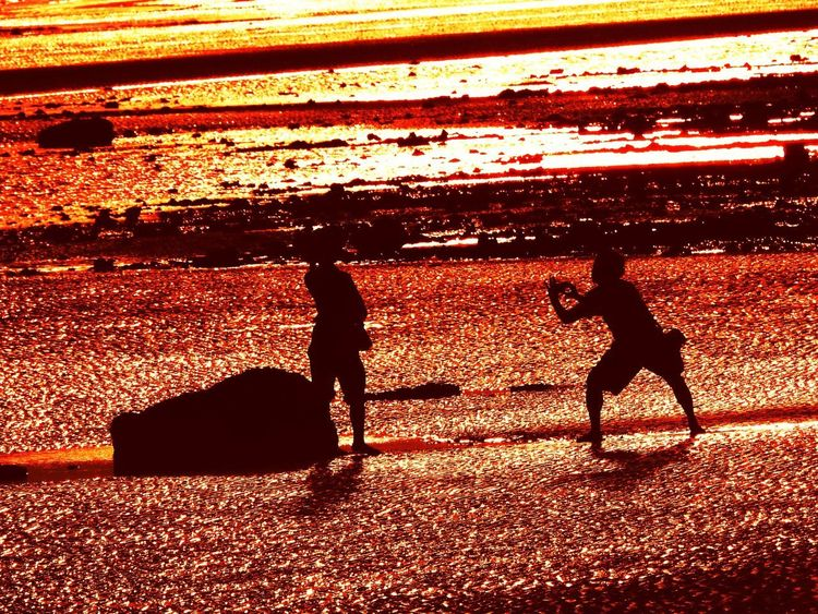 Sunlight Shadow Silhouette Nature Sunset Real People High Angle View Orange Color Group Of People People Men Lifestyles Sky Leisure Activity Unrecognizable Person Land Pets Outdoors Adult Togetherness