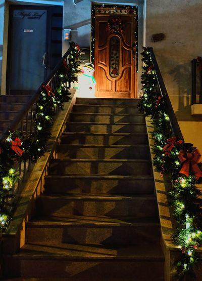 Illuminated christmas tree by building