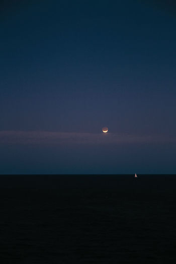 to the moon Sky Beauty In Nature Scenics - Nature Moon Tranquil Scene Space Tranquility Astronomy Horizon Night No People Nature Copy Space Idyllic Horizon Over Water Sea Land Water Non-urban Scene Outdoors Dark Planetary Moon Moonlight Eclipse Sailboat