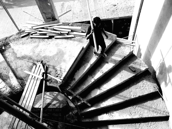 Going down Real People Working People Blackandwhite Light And Shadow Silhouette Minimalism Eyeem Philippines Monochrome Deceptively Simple Leading Construction Construction Work Architecture Shadow Lines Simplicity Creative Light And Shadow