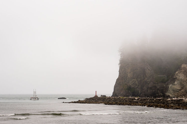 Boat on ocean Beach Beauty In Nature Day Fog Land Nature Nautical Vessel No People Outdoors Rock Rock - Object Sailboat Scenics - Nature Sea Sky Tranquil Scene Tranquility Transportation Water