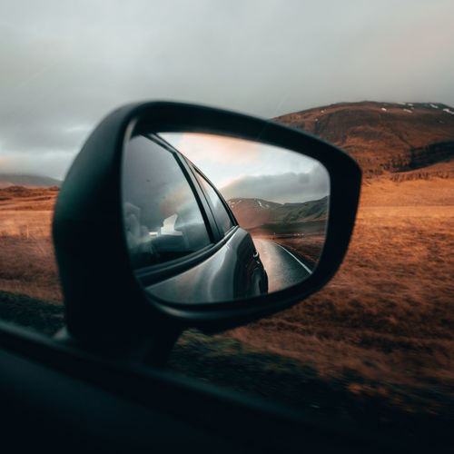 every travel story needs a car pic 😉 Landscape Iceland Moody Mood Nature North Volcanic Landscape Car Land Vehicle Vehicle Mirror Side-view Mirror Close-up Sky Rainy Season Wet Rear-view Mirror Rain Car Point Of View Car Interior Windshield Dashboard