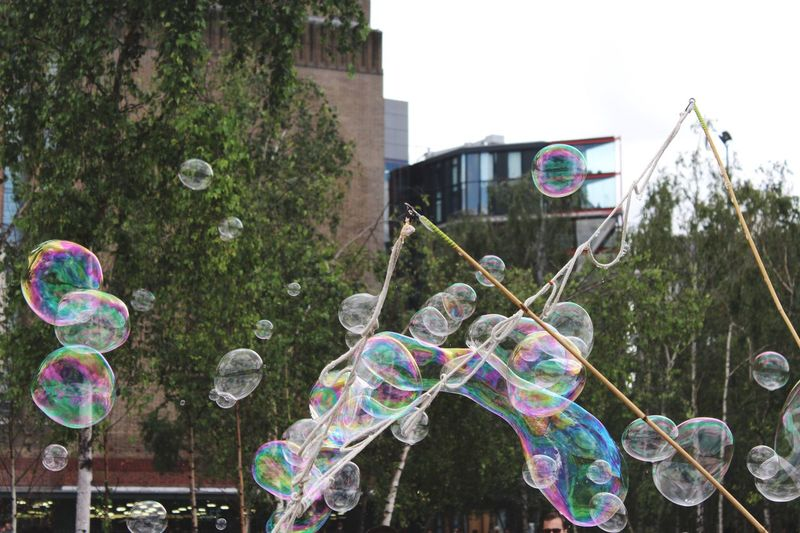 Bubbles Formed With Wand Against Buildings