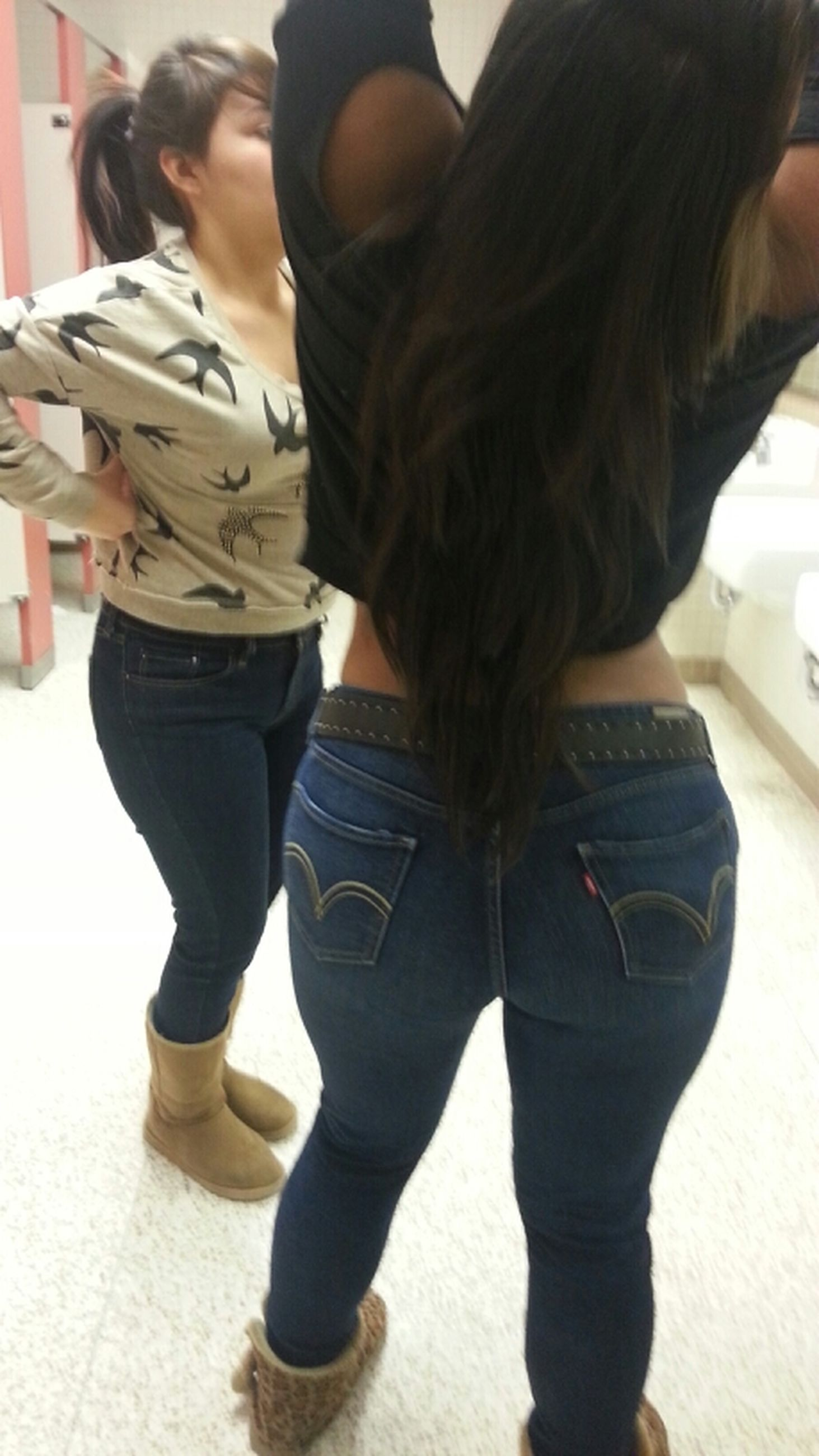 lifestyles, casual clothing, standing, person, indoors, leisure activity, rear view, low section, men, full length, walking, long hair, togetherness, side view, young adult, midsection