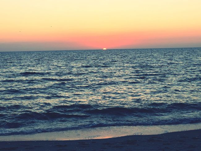 Almost gone. Sea Sunset Beauty In Nature Scenics Nature Water Horizon Over Water Outdoors Sun Clear Sky Sky No People Wave Beach Tranquil Scene Tranquility Day Rippled Idyllic Travel Destinations
