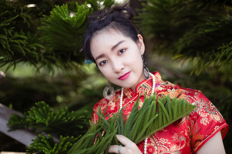 Portrait Looking At Camera One Person Real People Lifestyles Leisure Activity Front View Plant Focus On Foreground Green Color Women Red Headshot Child Young Women Young Adult Tree Beautiful Woman Hairstyle Chinese New Year Chinese New Year 2017