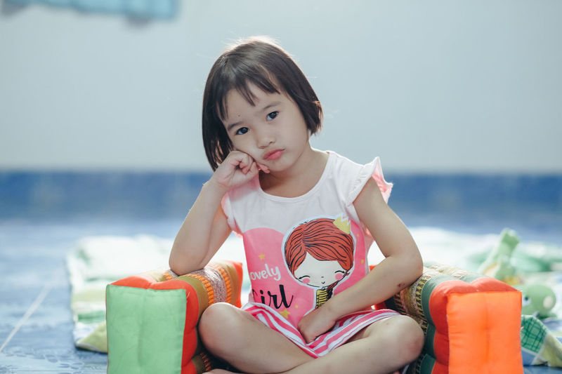 Cute girl sitting in sea