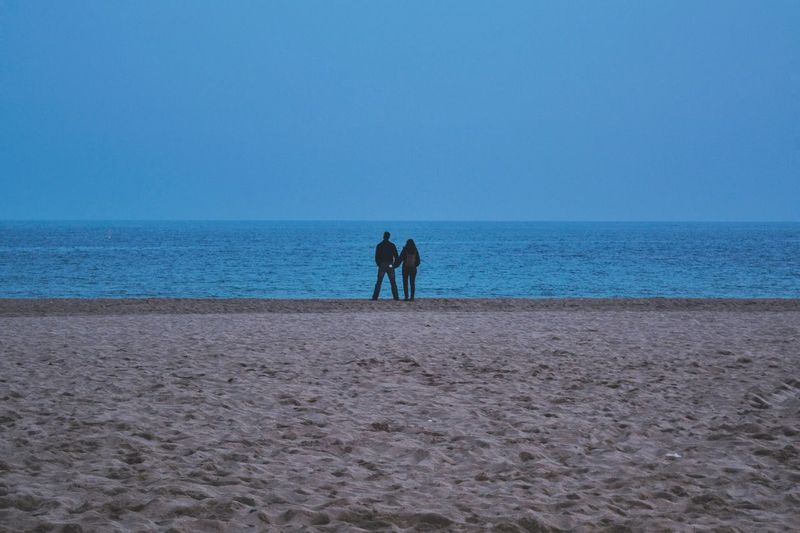 Sea Real People Sky Horizon Over Water Two People Nature Blue Beach Rear View Clear Sky Beauty In Nature Outdoors Scenics Sand Water Day Men Togetherness Mammal People Low Angle View Walk Old Urban Photography Travel Destinations