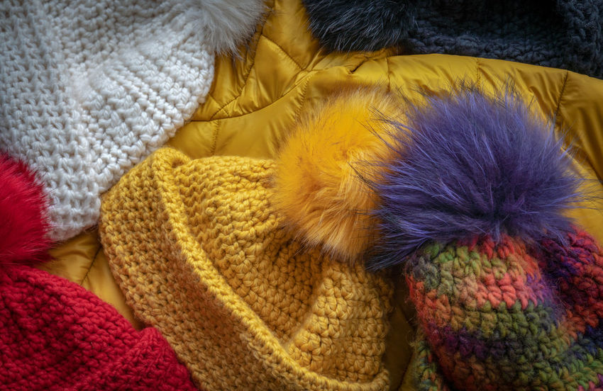 The EyeEm Collection Partner Collection Textile Indoors  Wool No People Close-up High Angle View Winter Relaxation Warm Clothing Clothing Yellow Softness Comfortable Multi Colored Cozy Hat Cap Winter Bobble Warm Cold Temperature Cold Days Colors Winter Ball Of Wool Material Partner Collection Partner Collection