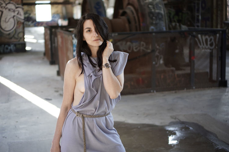 Portrait Of Beautiful Woman In Abandoned Factory