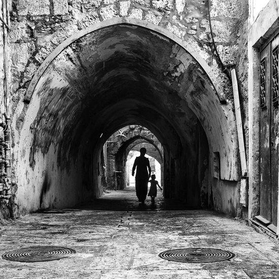The Illuminator - 2014 EyeEm Awards The Street Photographer - 2014 EyeEm Awards Street Photography Black & White Darkness And Light Smart Simplicity