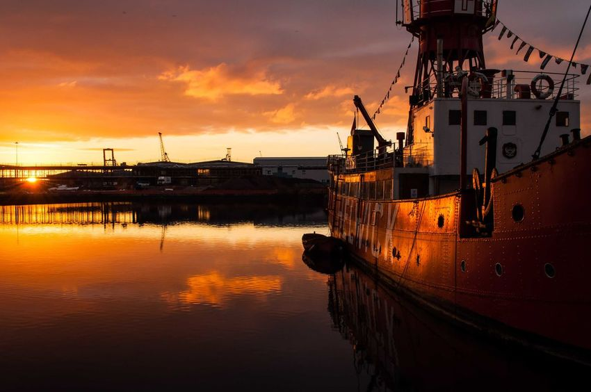 EyeEm Selects Reflection Water Nautical Vessel Harbor Commercial Dock Silhouette Sky Industry Sea Waterfront Floating On Water No People Moored Lightship Sunrise Golden Hour Cardiff Outdoors Wales Colours