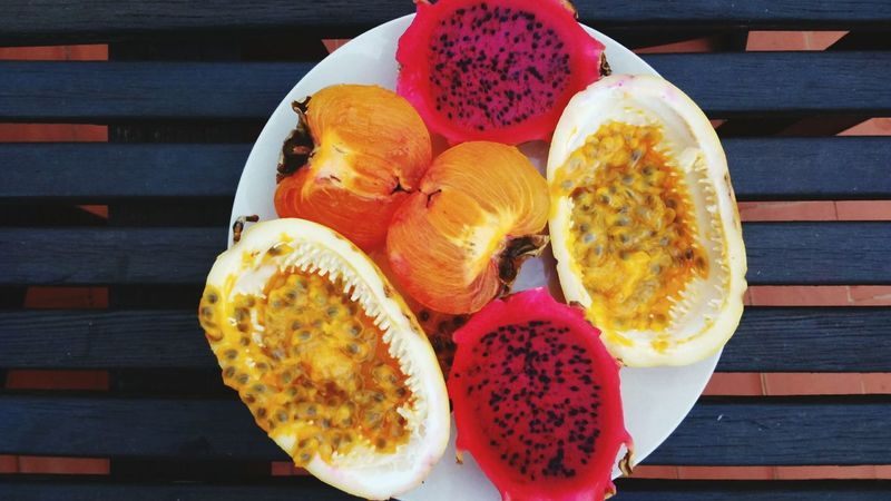 EyeEm Selects tropical fruits on the plate Food And Drink Healthy Eating Food Wood - Material Table Fruit Freshness Multi Colored Ready-to-eat Outdoors Maracujá Passion Fruit Dragon Fruit Food Stories