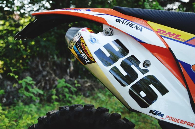 Ktm300xc KTMRacing Ktm Fmf Moto Cross Enduro Lifestyle Enduro Enduro Racing Pastro356 Day Communication Close-up Text No People Nature Outdoors Sign High Angle View Western Script Focus On Foreground Number Plant Road Sign Transportation Symbol Competition Safety Mode Of Transportation Sport