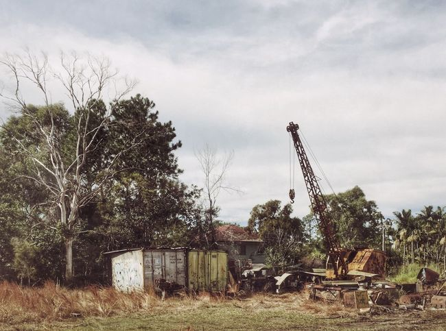 Tree Sky Abandoned Cloud - Sky Obsolete No People Field Damaged Day Architecture Outdoors Nature Building Exterior Factory Windmill Oil Pump