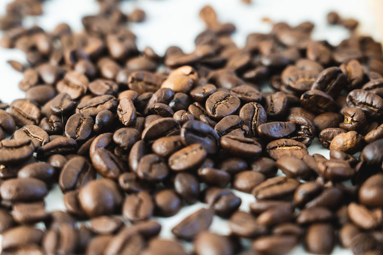 Pile of coffee beans close-up isolated on white background, with copy space Roasted Coffee Bean Coffee - Drink Coffee Large Group Of Objects Food And Drink Abundance Brown Selective Focus Still Life Roasted Food Close-up No People Indoors  Freshness Full Frame Coffee Bean Caffeine Backgrounds Drink Non-alcoholic Beverage