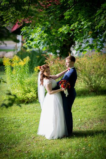 Love story Bride Bridegroom Celebration Couple - Relationship Full Length Grass Groom Happiness Heterosexual Couple Husband Life Events Love Men Real People Togetherness Two People Wedding Wedding Ceremony Wedding Dress Wife Women Young Adult Young Couple Young Men Young Women