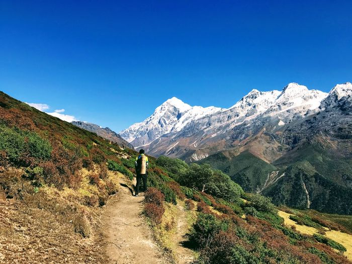 Mountain Scenics Beauty In Nature Nature Hiking Real People Leisure Activity Mountain Range One Person Day Adventure Clear Sky Tranquility Lifestyles Backpack Standing Full Length Outdoors Men Landscape