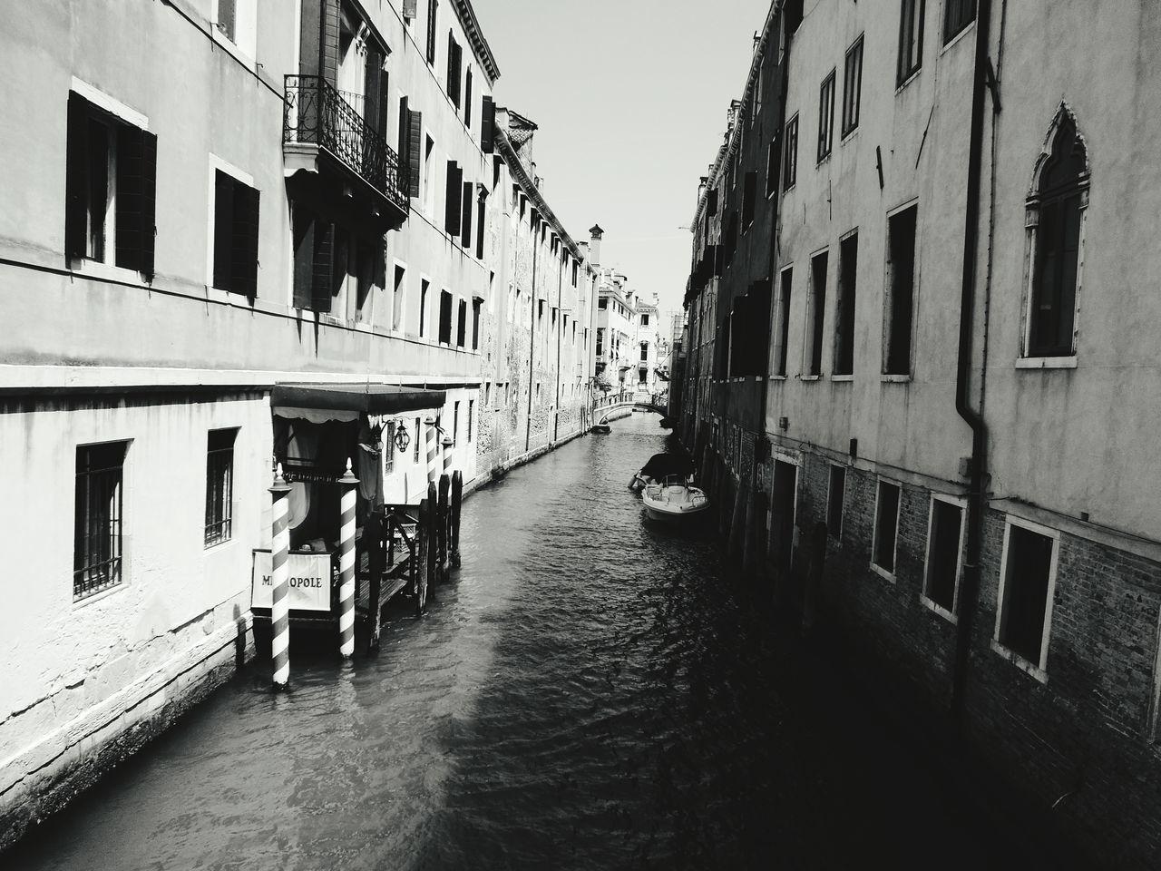 Narrow Canal Along Buildings