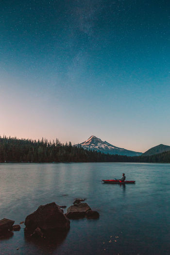 midnight cruse under the milky way LostLake Oregon Beauty In Nature Blue Clear Sky Copy Space Idyllic Kayak Lake Mountain Nature Nautical Vessel No People Outdoors Rock Scenics - Nature Sky Solid Tranquil Scene Tranquility Transportation Water Waterfront My Best Photo