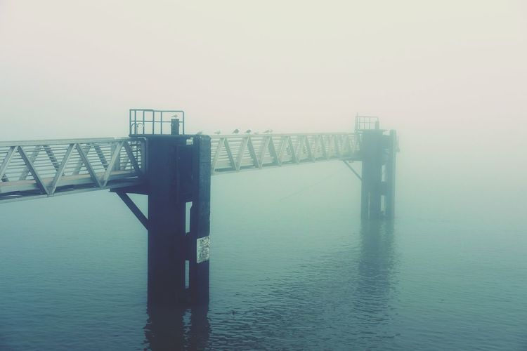 In the fog Sea Built Structure Water Architecture Clear Sky Connection Railing Nature Pier No People Sky Tranquility Outdoors Sunset Day Bridge - Man Made Structure Beauty In Nature EyeEm Best Shots EyeEmBestPics EyeEm Nature Lover Exceptional Photographs Landscape