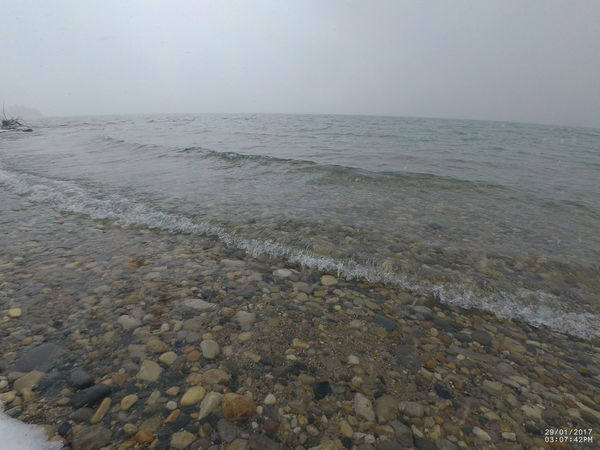 Beach Beauty In Nature Clear Sky Cold Days Day Freshwater Bay Horizon Over Water Lake Michigan Nature No People Outdoors Pebble Beach Pebbles And Water Scenics Sea Sky Smooth Water Snowing Stones & Water Tranquil Scene Tranquility Water Wave