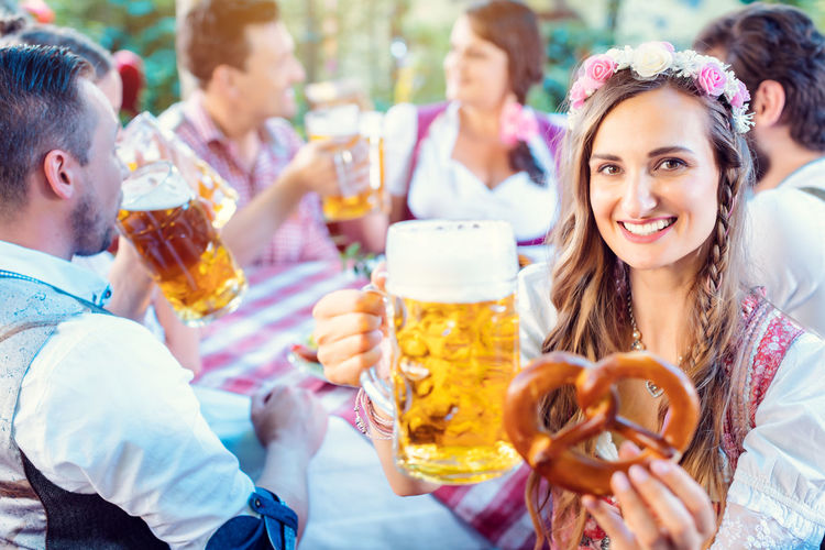 Young woman drinking glasses outdoors