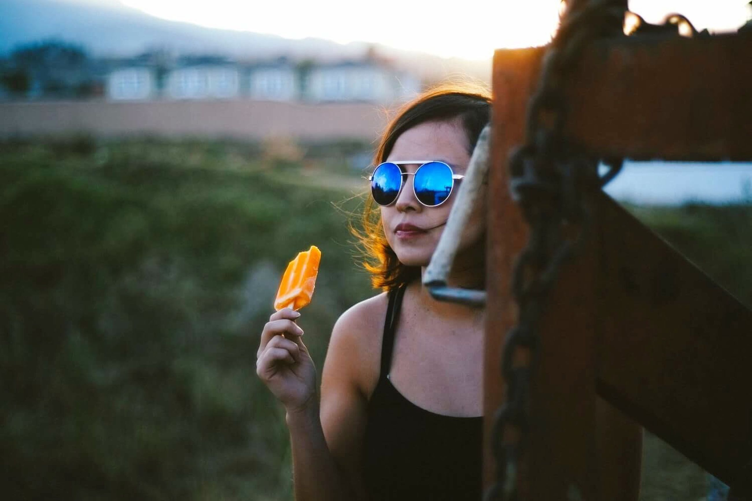 lifestyles, sunglasses, leisure activity, focus on foreground, portrait, headshot, sunlight, close-up, casual clothing, day, outdoors, sky, selective focus, nature