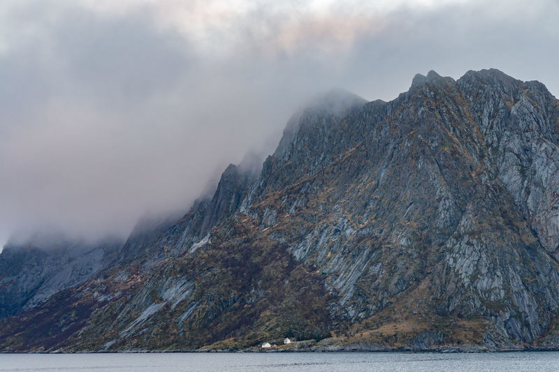 Mountain and clouds in Lofoten island, Norway Mountain Water Environment Nature Sky Scenics - Nature Wilderness Sea Rock Landscape Cold Temperature Urban Skyline Beauty In Nature No People Mountain Range Scenery Day Land Snow Outdoors Mountain Peak Formation Range High Lofoten