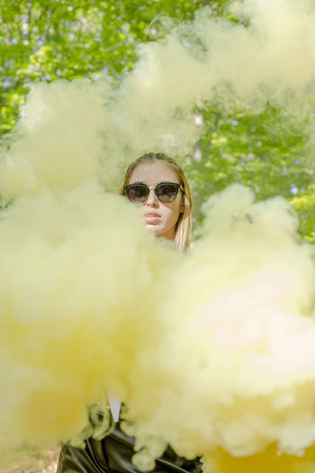 Smoke Bomb Sunglasses One Person Glasses Fashion Real People Portrait Young Adult Lifestyles Leisure Activity Front View Young Women Women Adult Looking At Camera Day Selective Focus Blond Hair Nature Outdoors Hairstyle Beautiful Woman