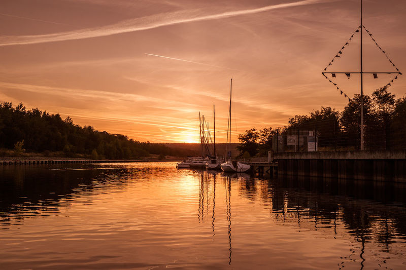 Berzdorfer See Görlitz / Zgorcelec Sonnenuntergang Beauty In Nature Cloud - Sky Electricity  Lake Mode Of Transportation Nature Nautical Vessel No People Orange Color Plant Reflection Sailboat Scenics - Nature Sky Sonnenuntergang Am Strand Sunset Tranquility Transportation Tree Water Waterfront