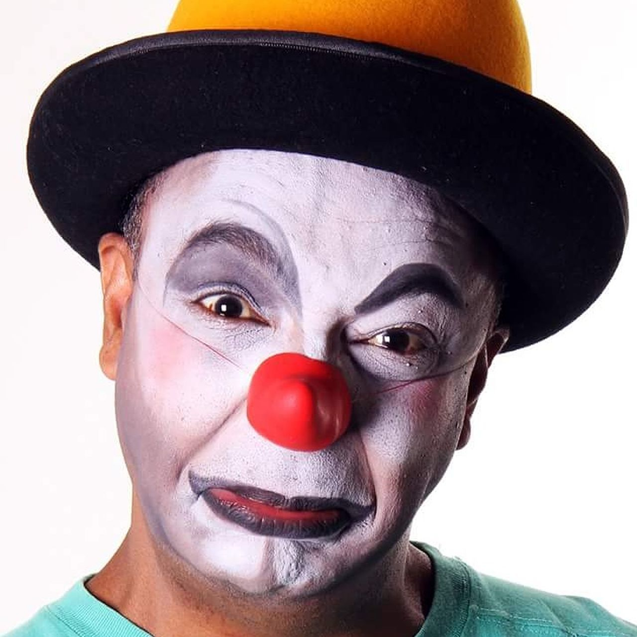 face paint, portrait, headshot, looking at camera, white background, studio shot, one person, young adult, human face, adult, red, one man only, clown, close-up, adults only, human body part, real people, men, facial mask - beauty product, only men, people, mime, fan - enthusiast, day