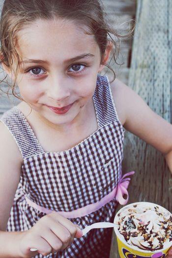 Portrait of smiling girl eating ice cream