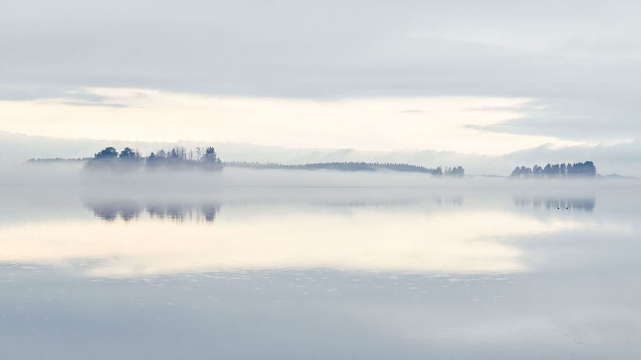 Misty Architecture Beauty In Nature Cloud - Sky Cold Temperature Day Fog Mist Nature No People Outdoors Reflection Scenics Sky Tranquil Scene Tranquility Water Waterfront Colour Your Horizn