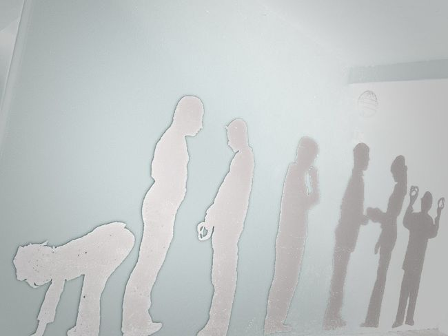 Humans Standing On A Wall Shadows Blue Background Perspective Art On The Wall