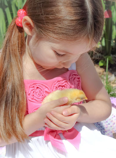 Baby Animals Blond Hair Childhood Close-up Cute Elementary Age Focus On Foreground Freshness Girls Headshot Holding Innocence Inspiring Kids And Baby Animals Kids And Nature Leisure Activity Lifeisbeautiful Lifestyles New Beginings New Life New Life & New Hope Person Pink Color Spring Springtime